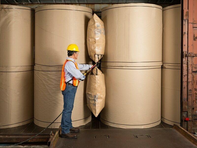 paper-dunnage-air-bag-paper-rolls-rail-min